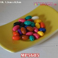 MP5605	Mote Plastik Lonjong Warna Warni uk 5x13mm (1 bks isi 12)